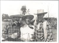 Karl Koerper stands with two unidentified men all in Western wear