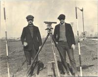 L. Perry Cookingham with unidentified man and survey equipment
