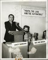 "Leroy Barrows at podium of panel forum: ""Youth, the law, and the automobile"" at the KC Mace Conference, 1967"
