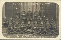 Co B of the 310 Field signal Battalion pose in front ornate doors