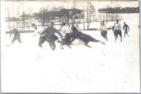 Army Company playing Football in the snow