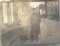 Lt. Schoonover, and Lt. Gaskill stand in unidentified street