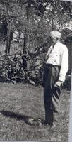 Joseph Fitch Cookingham standing outside