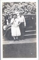 Joseph F. Cookingham and Mame Gordinier stand besides car