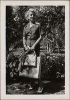 Martha Jane Starr standing in front of tropical foliage