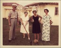 John W. Starr and Martha Jane Starr with two unidentified women in front of a house