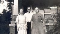 Ella Cookingham stands next to unidentified man and woman