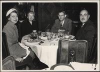 L. Perry Cookingham sitting at a table with Harriette W. Cookingham and Mr. and Mrs. Lathrop Backstrom