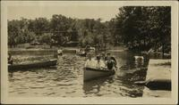 John W. Starr with group of unknown people in a small boat at Phillips Ranch