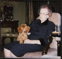 Martha Jane Starr with a brown miniature poodle