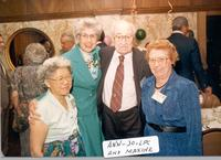 Ann Bickert, Jo, L. Perry, and Maxine stand shoulder to shoulder