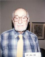 L. Perry Cookingham wearing blue plaid shirt and yellow tie