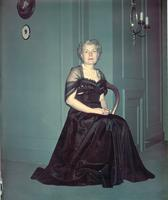 Harriette W. Cookingham seated in black dress