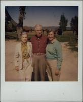 Martha Jane Starr and John W. Starr standing with an unidentified woman