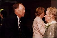 Bill French speaking to Martha Jane Starr with Mary Kay McPhee in the background