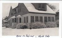 Exterior shot of snow covered two toned house at 105 Gratiot Ct.