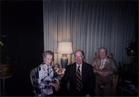 Martha Jane Starr, John Philip Starr, and John W. Starr sitting the sunroom at Starr Residence