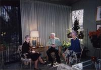 Martha Jane Starr, John W. Starr, and unidentified woman in the sunroom at Starr Residence