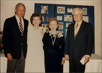 Unknown man and woman with Martha Jane Starr and John W. Starr at Boy Scout needlepoint exhibit
