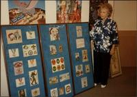 Martha Jane Starr with her Boy Scout needlepoint exhibit