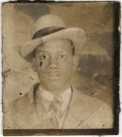 Photo of a young man in a hat