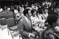 Buck and Pat Clayton seated at their daughter's graduation
