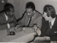 Buck Clayton with Don Byas and Armand Conrad at a restaurant in France