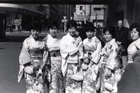 Japanese women posing for a photo