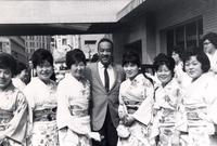 Buck Clayton posing with a group of Japanese women