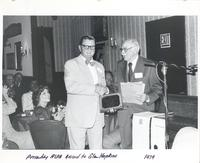 Glen Hopkins receiving the American Society for Public Administration's L.P. Cookingham award