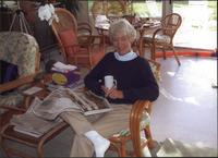 Barry Starr, holding a newspaper and cup of coffee