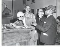 Four unidentified men in a post office