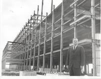 Richard Bolling standing at construction site
