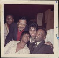 Buck Clayton, Kenny Clarke, and possibly Nancy Wilson smiling for the photographer