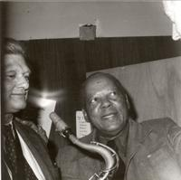 Zoot Sims and Budd Johnson talking with a fan