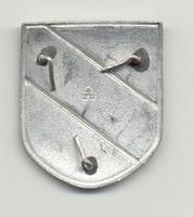 Back of German WWII Black, Silver, and Red Banner Shield that was worn on the tropical Pith Helmet, Insignia-Army Africa Korps, Unidentified mark in center of back of shield. 3 prongs intact.