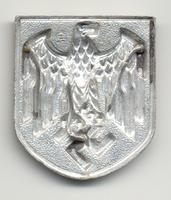 Back of German WWII Eagle Shield that was worn on the tropical Pith Helmet, Insignia - Army Africa Korps. Unidentified mark on back of shield, 3 prongs intact.