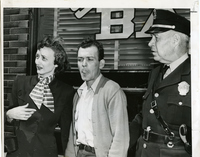 Mr. and Mrs. Cantino with an Officer After the Robbery