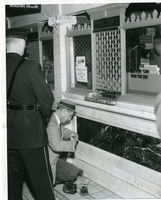 Detective Dusting For Fingerprints At The Scene Of Robbery--Mercantile Trust Co.